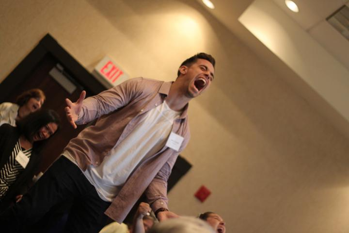 "Aspen Lake's Jake Corrent plays ""Simon Scream"" during an Innovation Summit session on theatre and improv as a tool the enhance life quality and improve mental health."