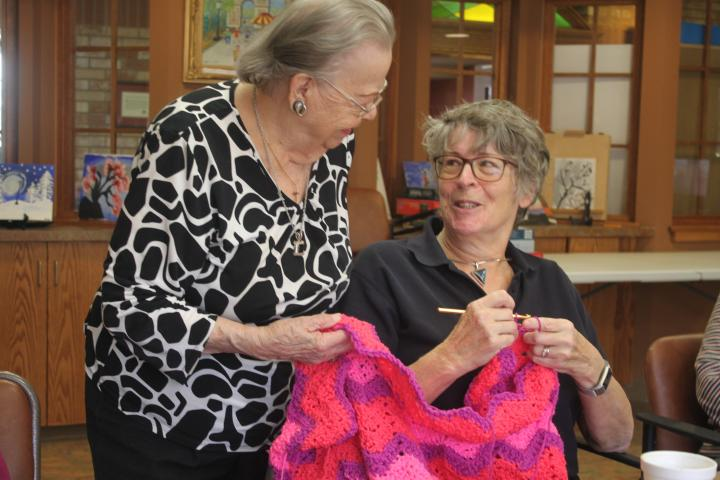 Maria and Irene,Volunteers of the Humber Heights Knitting Club.