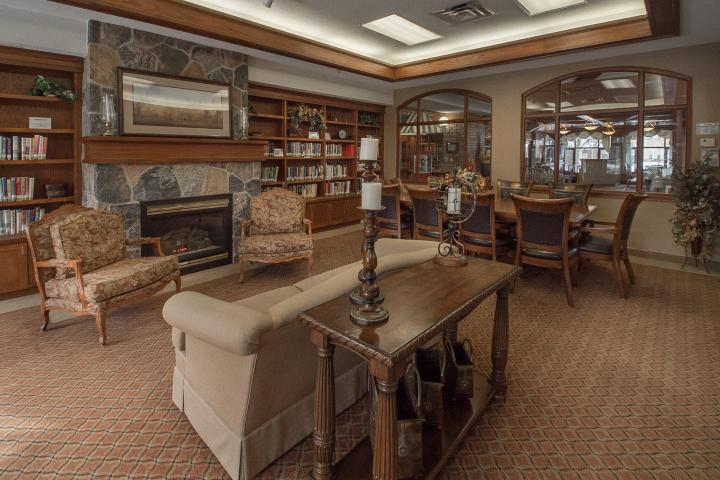 Read a book in the Library at The Village of Riverside Glen in Guelph