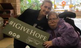 Renee and Nikki promote the Wilfred Schlegel Hope Fund in The Village of Aspen Lake.