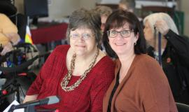 Kathy Crump (left), alongside her sister for the announcement that Coleman Care Centre will be expanding.