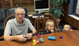 "Norm, Ivy and Wes at a recent visit to Riverside Glen. Ivy ""has asked every day since then if we can go back to Pop-Pop's place to play playdough,"""