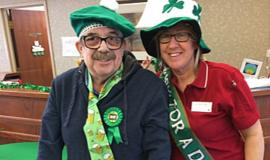 Doug and Kim celebrating St. Patrick's Day together. Kim says the CONNECT The Dots customer service training has helped the team at Riverside Glen support Doug even better
