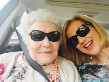 Sigrid and Karen taking a picture together in a car