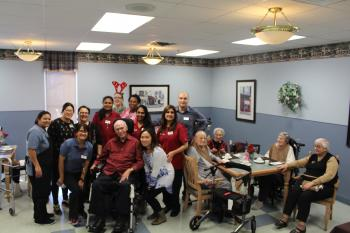 Dundas Neighbourhood group photo with team members and resident