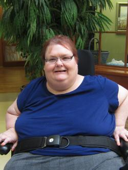 Resident Renee sitting on her wheelchair