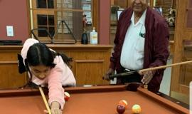 Azm and his daughter Omnia shoot a little pool together at Erin Meadows.