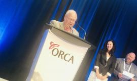 Ron Schlegel proudly accepts the Donna Holwell Legacy Award, presented by the Ontario Retirement Communities Association.