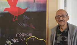 Mr. Mansaram stands beside one of his many great pieces of art.