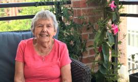 Rita Munro upon her balcony at Ailsa Craig in TheVillage of Arbour Trails in Guelph.