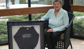 Ruth sits alongside the sweatshirt from Humber Heights school she gave her son more than 40 years ago.