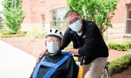 Noel and Victor ride the duet bike at The Village at St. Clair in Windsor