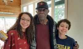 Vasil with his grandchildren, Emerson and Ronan. The children gave their Papa and his fellow residents the gift of music in a virtual piano concert