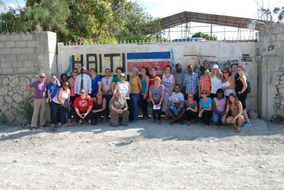 Group of Schlegel Ambassadors standing in front of the Communitere in Haiti