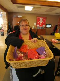 Resident Renee holding a basket of crafts