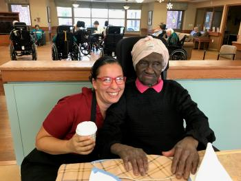 As a dietary aide, Chantal was able to develop more  meaningful connections with residents when a dishwasher in the neighbourhood created efficiencies. Albertina is just one of  many residents Chantal enjoys connecting with at St. Clair.