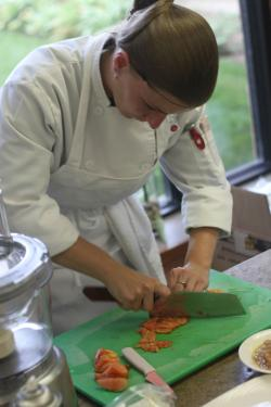 A chef chopping up vegetables