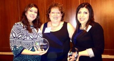 Michelle Wood, Michelle Vermeeren and Hiam Elabd from Glendale Crossing holding a glass award