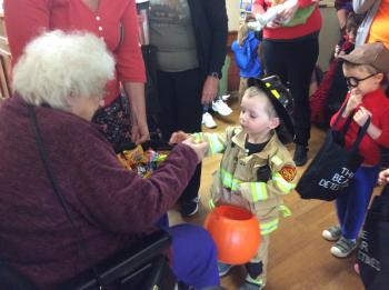 Riverside Glen residents welcomed young people in for a trick-or-treat warm-up before Halloween.