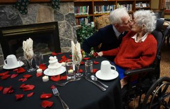 Jim giving his wife Vera a kiss in the Riverside Glen library