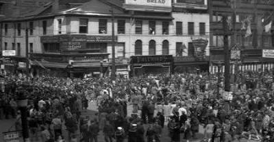 Stella Curtis was among this crowd at the Corner of King Street and  James St. In Hamilton on VE Day, May 8, 1945. Photo courtesy of the Hamilton Public Library.