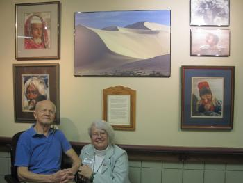 Steve Menich and Barb Sutcliffe in front of one of his photos