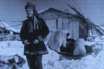 Black and white photo of Morris standing in the snow in traditional Norwegian garb